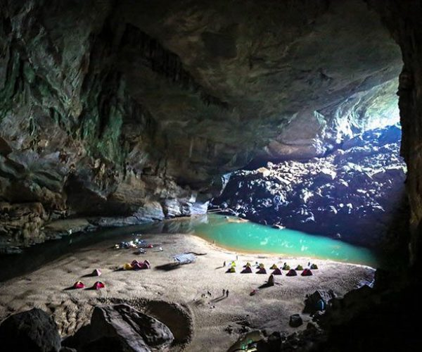tents-and-small-people-in-a-cave-vietnam-parinazbilimoria